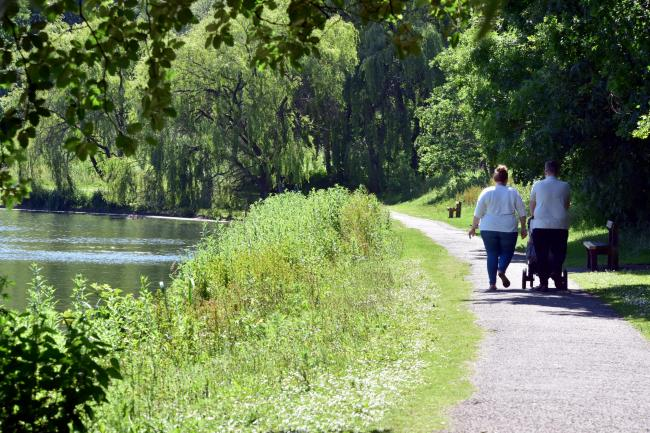 Sun seekers enjoy the weather at Moses Gate Country Park.