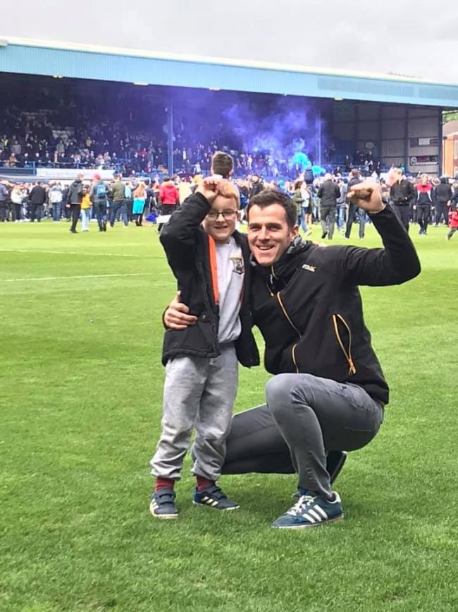 Dad and Owen on the pitch after Shakers got promoted.   Amber in the local family pub celebrating a 3-0 win over Northampton.  Dad, Amber and Owen in the south stand.   Hannah and Chris having a selfie outside the stadium.