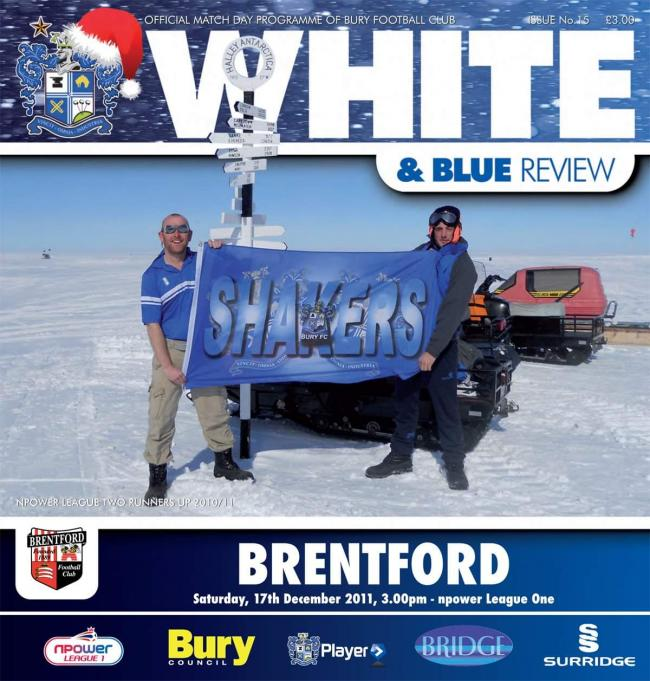 My husband Chris Holt made it onto the cover of the program because he took his colours to the Antarctic when working there. Bury went up and then the last one is Chris getting his shirt signed by his hero Ryan Lowe.