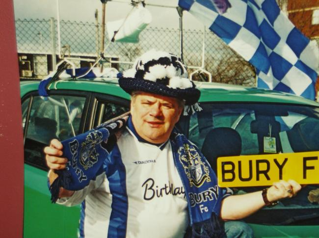 This my dad Paul Perry  he would deck his car out in Bury gear and when we did the save our shakers a few years ago he would go around Bury  with the loud speaker on the car trying to get people to the game.  When he became ill I used to take him to the games as his carer and was made more than welcome by the supporters.  I took over his season ticket and still buy a ticket every season and go to the games and have done for the past 15 years.