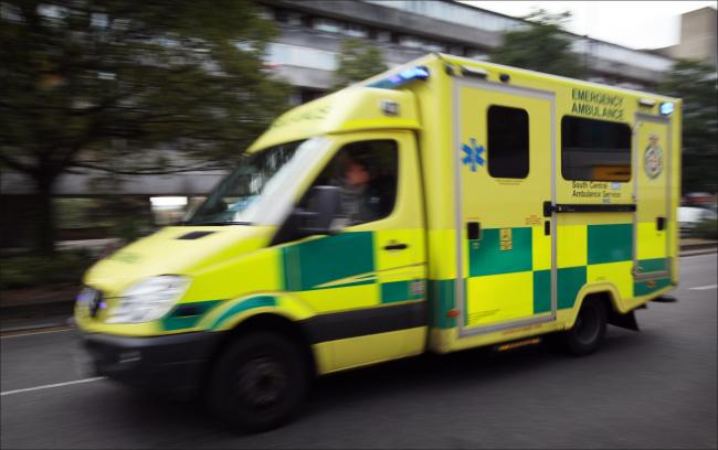Ambulance speeds along on an emergency call down Commercial Road. Stock. Wednesday 22nd October 2014.