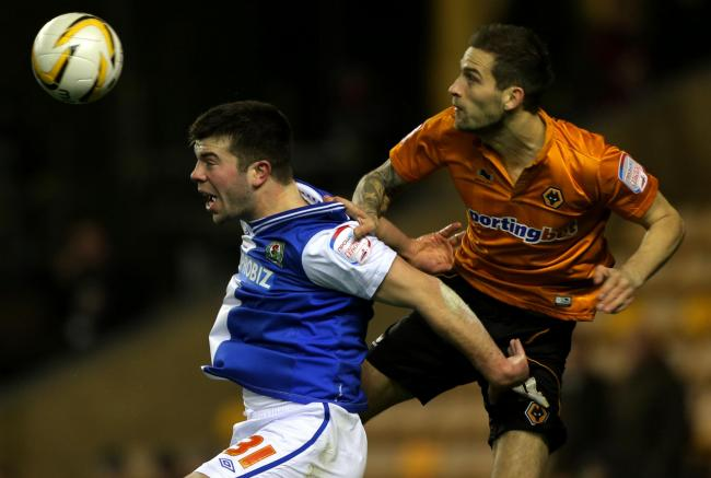 Roger Johnson, right, in action during his Wolves days