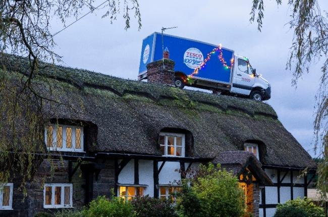The delivery van on the cottage roof