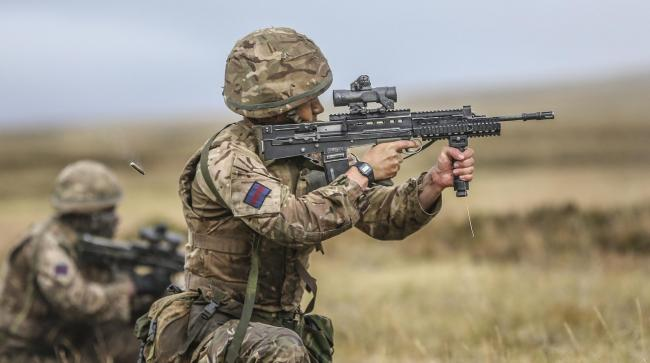 Pictured are soldiers from The Household Division operating their SA-80's during a live fire exercise, training thousands of miles from home on the infamous Onion Ranges in the Falklands...The Onion Range is a vast swathe of land which is used for tra