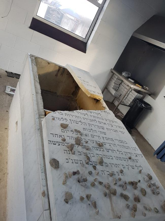 CRIME: The headstone of Rabbi Yehuda Zev Segal's grave was desecrated during an attack on Philips Park Jewish Cemetery last February.