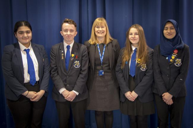 RESULT: Headteacher Helen Hubert with pupils at The Derby High School