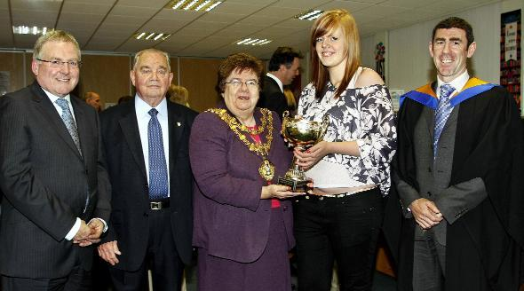 Bury Times: PRIZEGIVING: From left are retired headteacher Alan Scott; chairman of governors Jack Kenneford; Mayor of Bury Cllr Sheila Magnall; winner of the Nugent geography trophy, student Helen Bradshaw; and new headteacher Brian Duffy