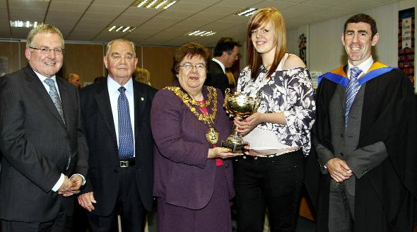 PRIZEGIVING: From left are retired headteacher Alan Scott; chairman of governors Jack Kenneford; Mayor of Bury Cllr Sheila Magnall; winner of the Nugent geography trophy, student Helen Bradshaw; and new headteacher Brian Duffy