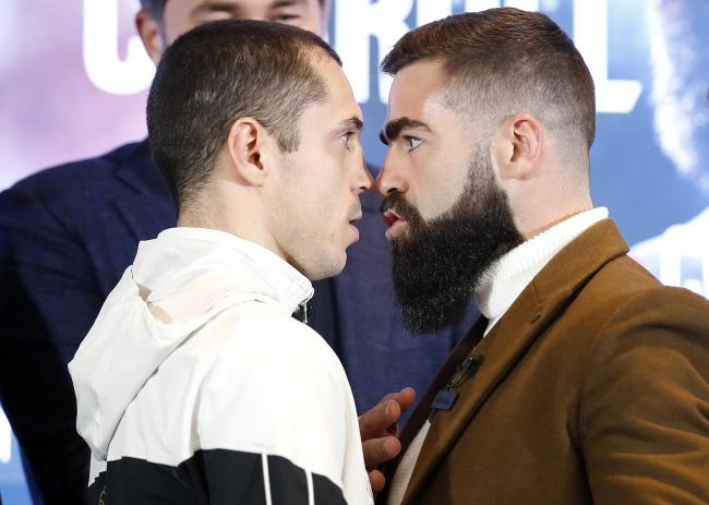 Scott Quigg (left) head-to-head with Jono Carroll at the final press conference