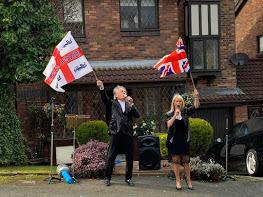 Brian and Maxine Warner perform to their neighbours outside their Prestwich home during coronavirus outbreak