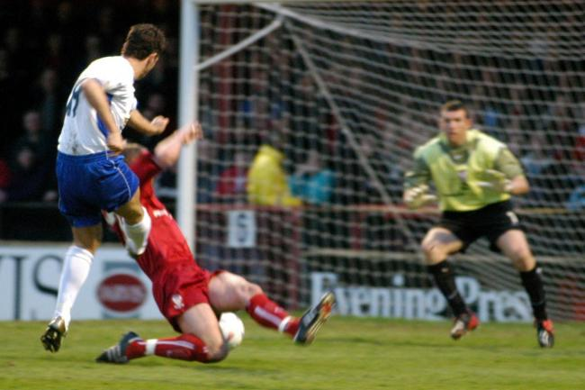 Gareth Seddon scores past York City's Mark Ovendale at Gigg Lane in a 1-1 draw in 2004