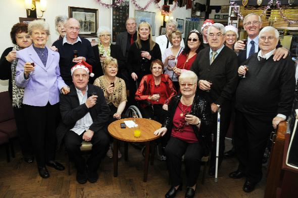 LINKING TOGETHER: Befrienders and service users enjoy a sherry reception