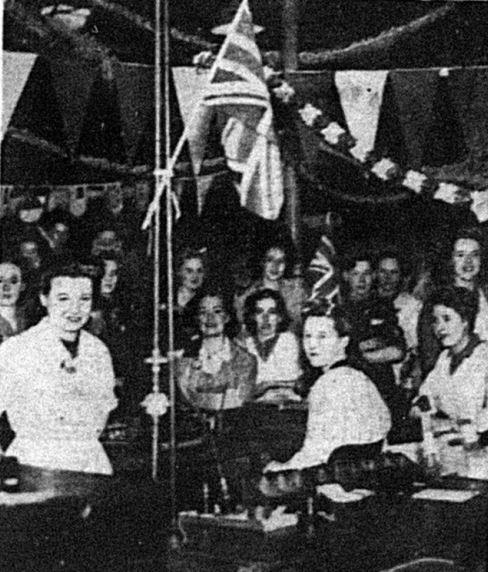 Workers at the Ferranti's factory in Bury, decorated to celebrate VE Day in 1945