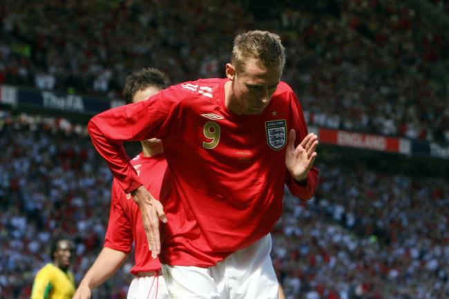 England's Peter Crouch celebrating his second goal during the friendly international against Jamaica at Old Trafford