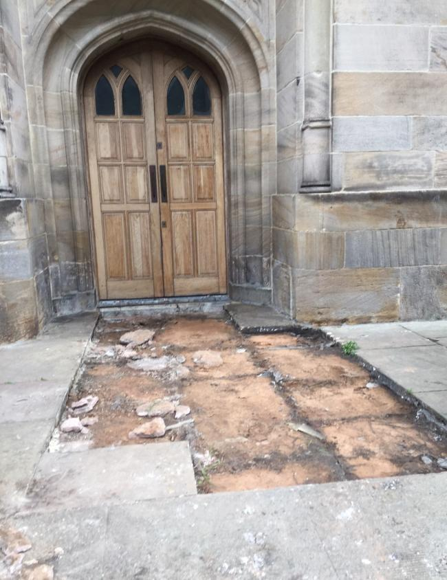 Damage left by thieves who stole York Stone flags from All Saints' Church in Stand.