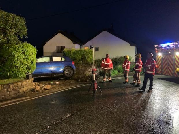 Bury Times: Fire crews on the scene after blue Volkswagen golf crashed into a driveway off Bradshaw Road in Walshaw, Bury