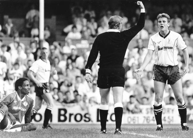 Phil Parkinson is told off by ref Neil Midgley after a foul on Manchester United's Paul Ince in 1990