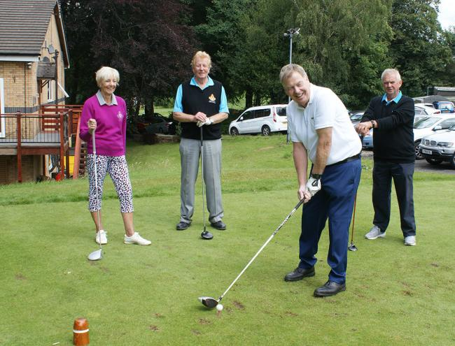 Mike Fitzpatrick on the first tee at the revamped Prestwich Golf Club watched by Barbara Elliott, Derek Hopkins and Pete Howard