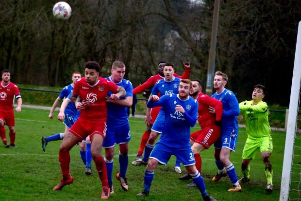 Bury Times: Prestwich Heys, in red, in action against Nelson