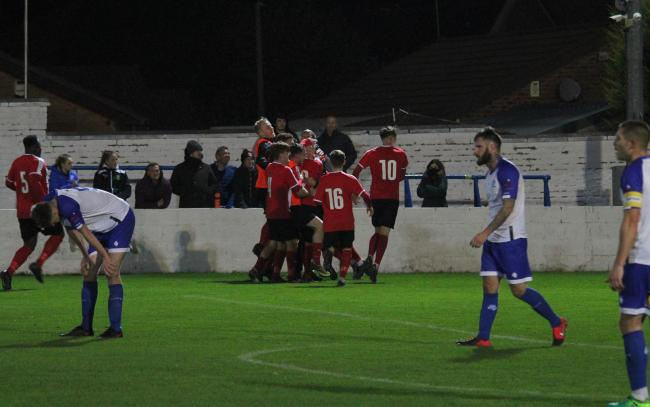 Prestwich Heys celebrate Jack Coop's late winner. Picture: Beth Lee
