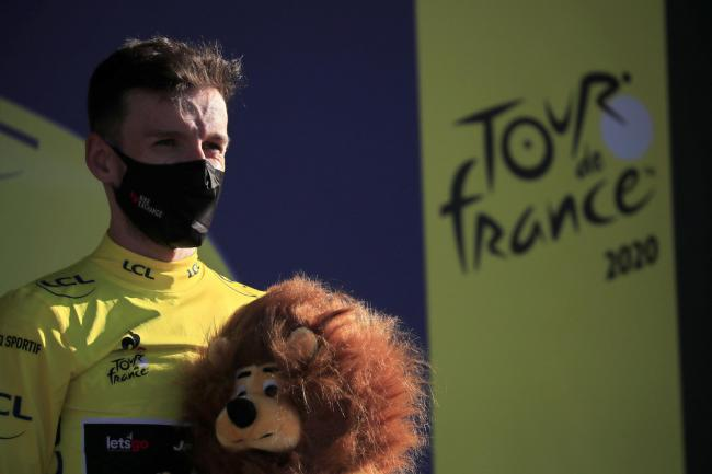 Britain's Adam Yates, wearing the yellow jersey of the overall leader, stands on the podium after completing the fifth stage of the Tour de France cycling race over 183 kilometers (113,7 miles) with start in Gap and finish in Privas, southern France,