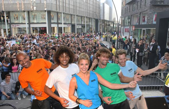 AIR GUITAR ACT: Actress Gemma Atkinson leads the world record attempt on The Rock opening day