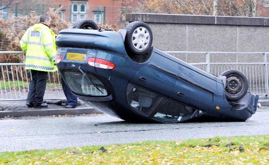 Driver's  lucky escape as car overturns