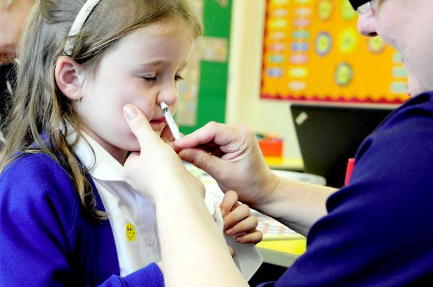 PROTECTION Imogen Sowerby, aged four, receives the new nasal flu vaccine at Christ Church Primary School, Ainsworth