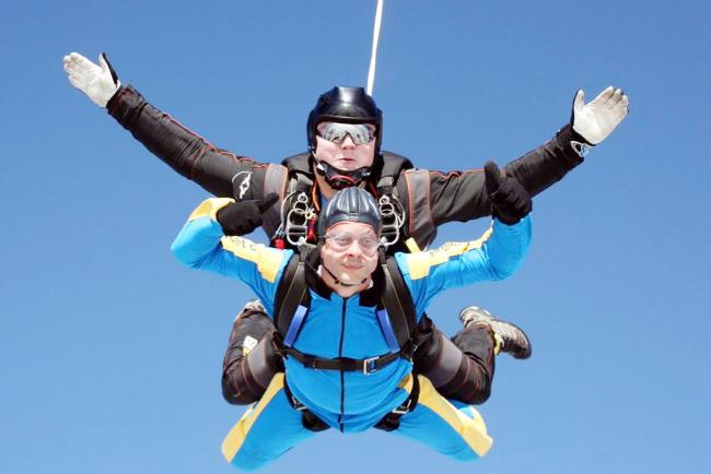 HIGH THERE: Lou and Andre Keen during their parachute jump for Joshua's charity