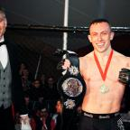 Bury Times: Richard Buskin after winning the lightweight UFW champion belt