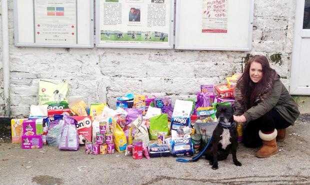 Melissa Parry with Rolo, a dog from Bleakholt Animal Sanctuary and donations made by shoppers