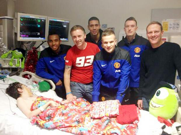 Bury Times: United stars Anderson, Chris Smalling, Tom Cleverley and Phil Jones and Coronation Street star Antony Cotton at Josh's bedside