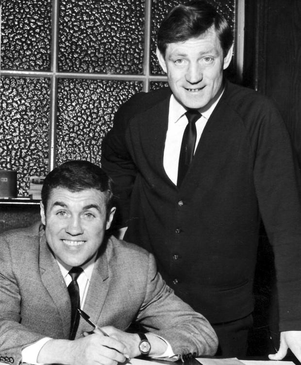 Bury Times: Bobby Collins, left, signs for Bury in 1967 with manager Les Shannon