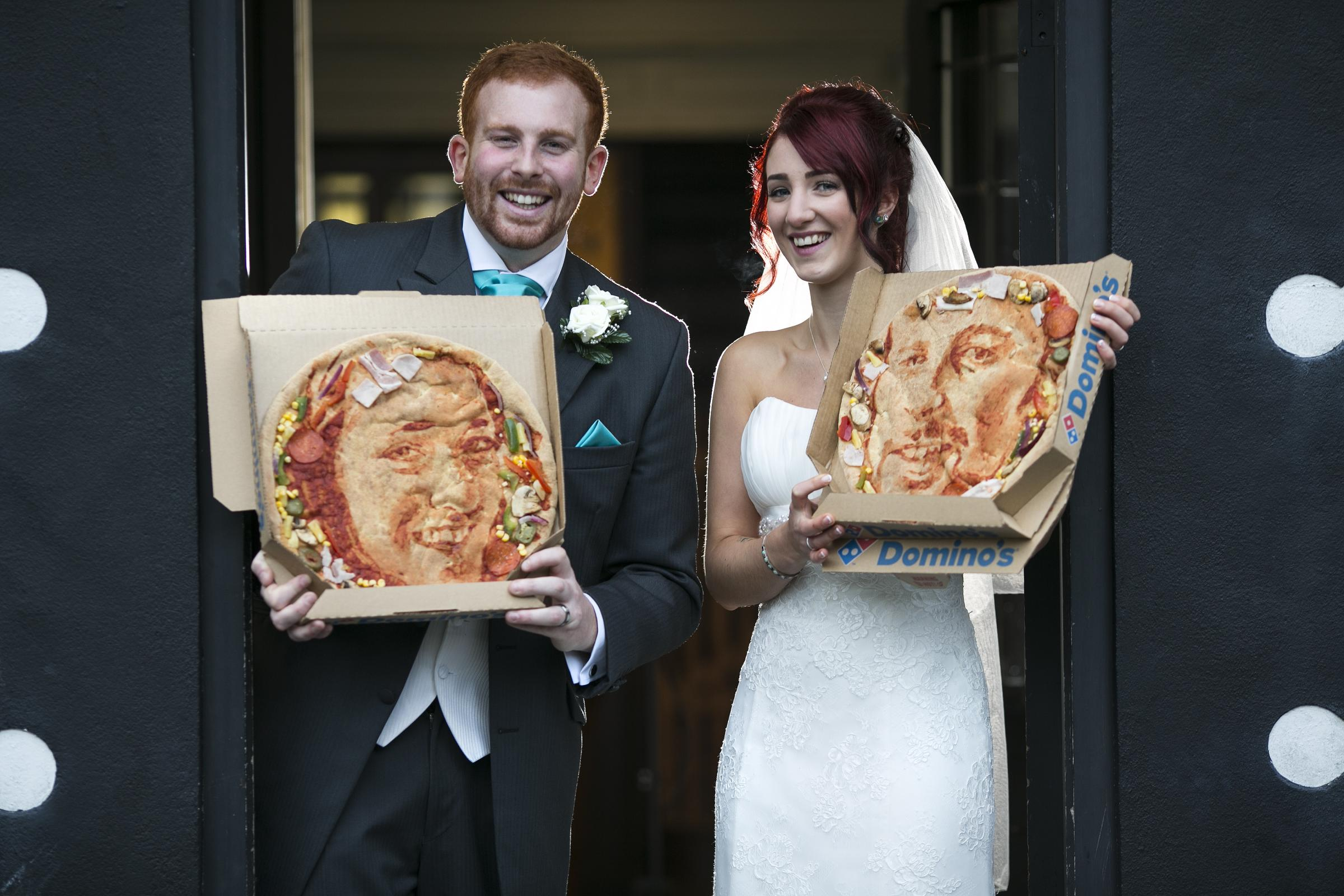 Newlyweds celebrate with pizza selfies