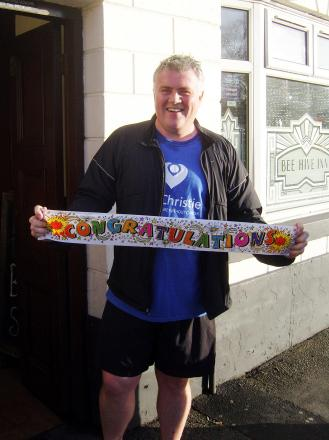 Barry O'Brien celebrates his final run of the year at the Bee Hive Inn