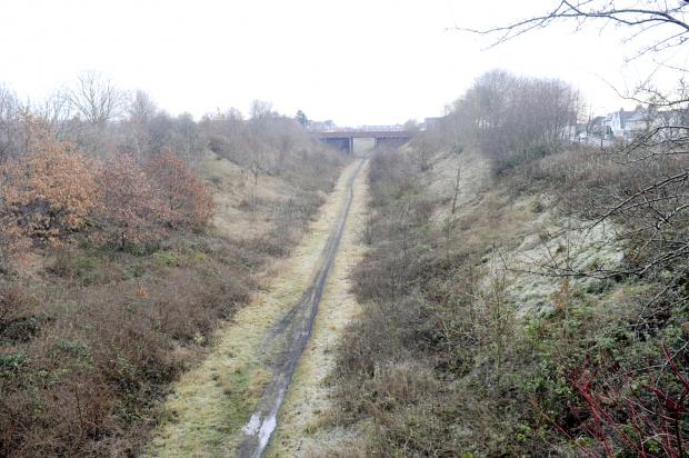 Bury Times: Part of the disused railway line near Gorses Road, Breightmet, which will be used to create the cycling/walking route