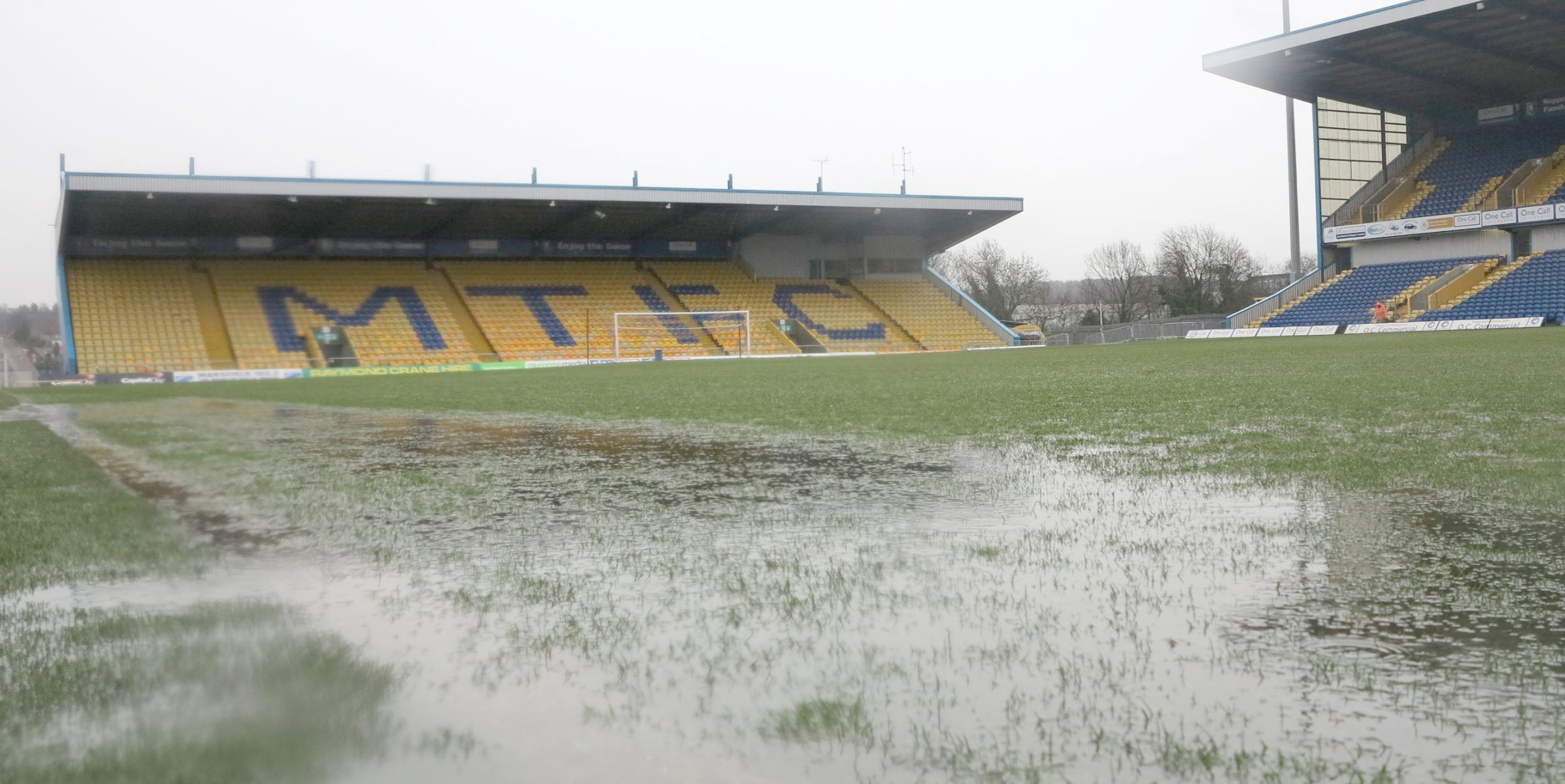 The puddles covering the pitch at Mansfield Town's One Call Stadium when the game was postponed earlier this month