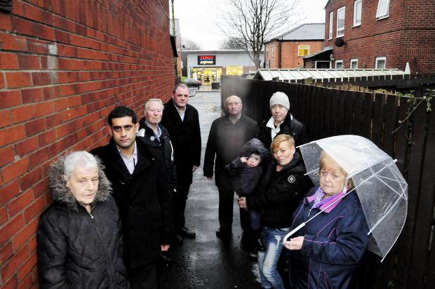 Front left is Laura Farmes with Cllr Rishi Shori. Also pictured are Cllr Tony Isherwood and Cllr Tony Cummings, back left and right, with other residents. The Tesco Express is in the background.
