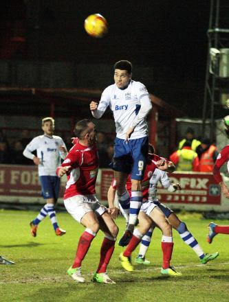 Anton Forrester heads over for Bury at Accrington