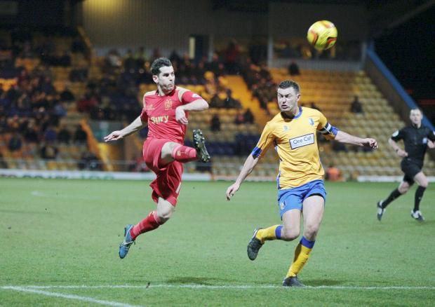 Daniel Nardiello sends the ball on its way for his second goal in a 4-1 win at Mansfield Town on Tuesday night