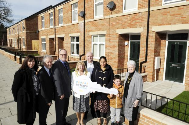Charlie Norman, chief executive St Vincent's, Hugh Broadbent, chairman of Six Town Housing, Cllr Mike Connolly, Cllr Sharon Briggs, Mayor of Bury, Roy Knowles of St Vincent's Housing Association, new residents Sara Rahman, and Alex Duckworth, aged sev