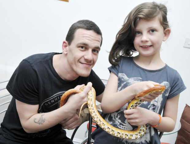 Bury Times: Stuart Smith and his daughter, Kiera, aged nine, reunited with his snake, called Mysterious