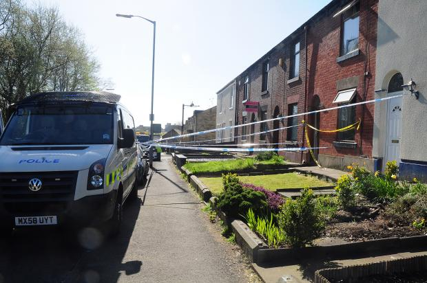 The blaze house in Tottington Road, Bury, is cordoned off