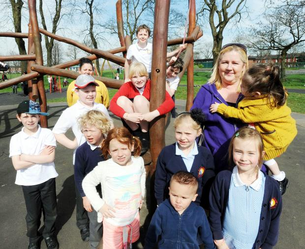 Bury Times: Childminder Catherine Thornley at Whitehead Park with some of her charges