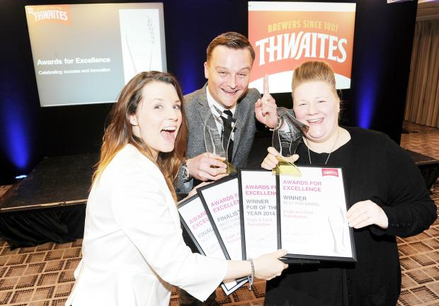 Bury Times: From left, Eagle and Child assistant manager Rosie Hollis, Glen Duckett and head chef Eve Townson