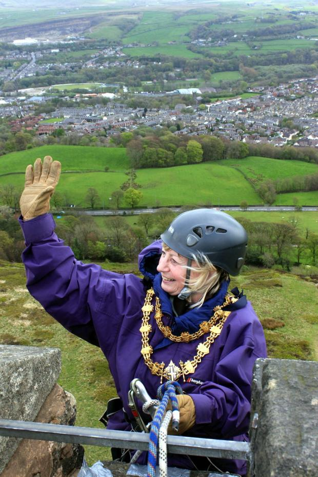 Bury Times: The Mayor of Bury, Cllr Sharon Briggs, abseils from Peel Tower
