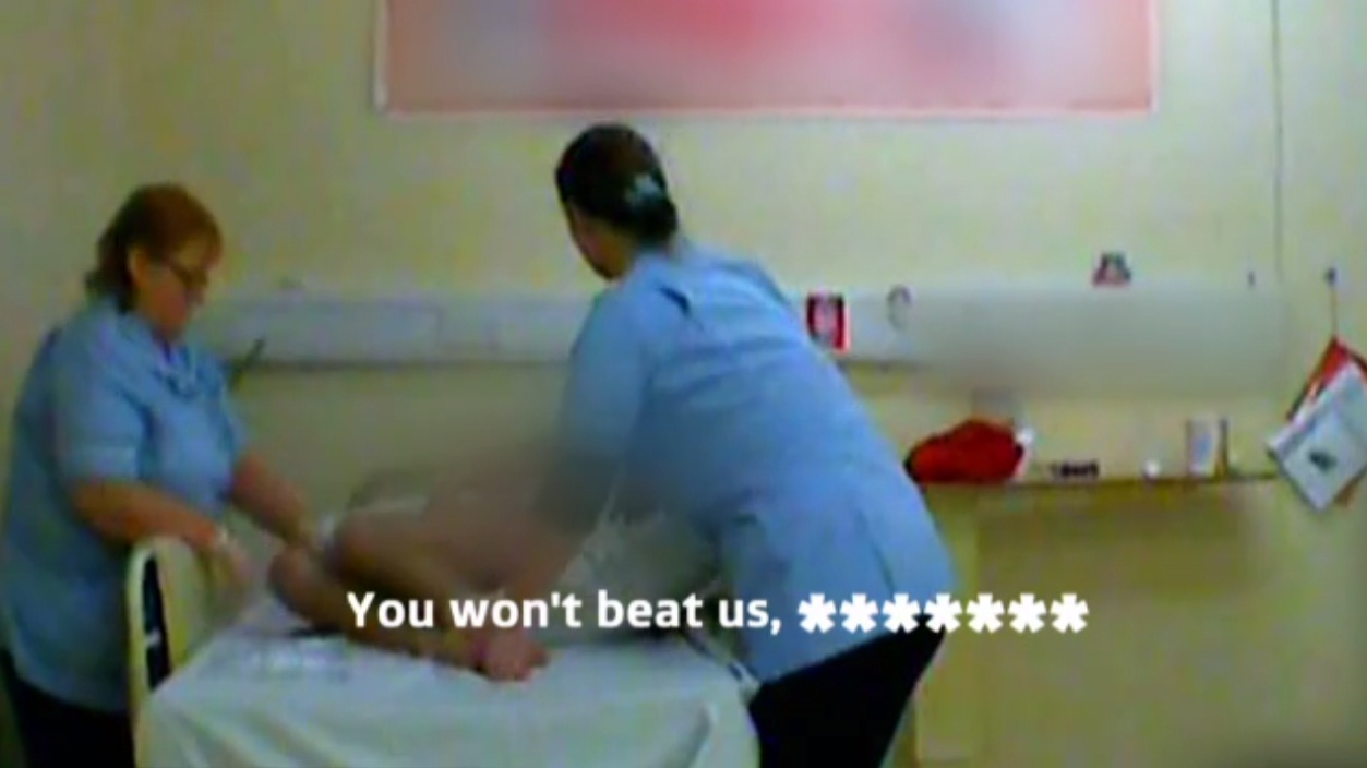Rita Page and Lynette Crook abusing Daniel Moran in the secretly filmed footage. Picture from ITV News video.