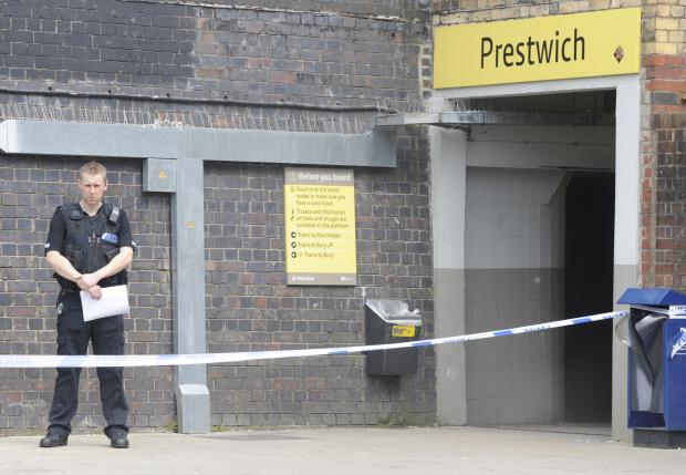 Police guard the scene at Prestwich Metrolink