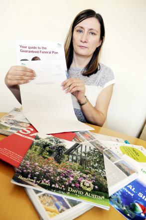 Julie Moran with some of the mail Daniel Noon had sent to her home