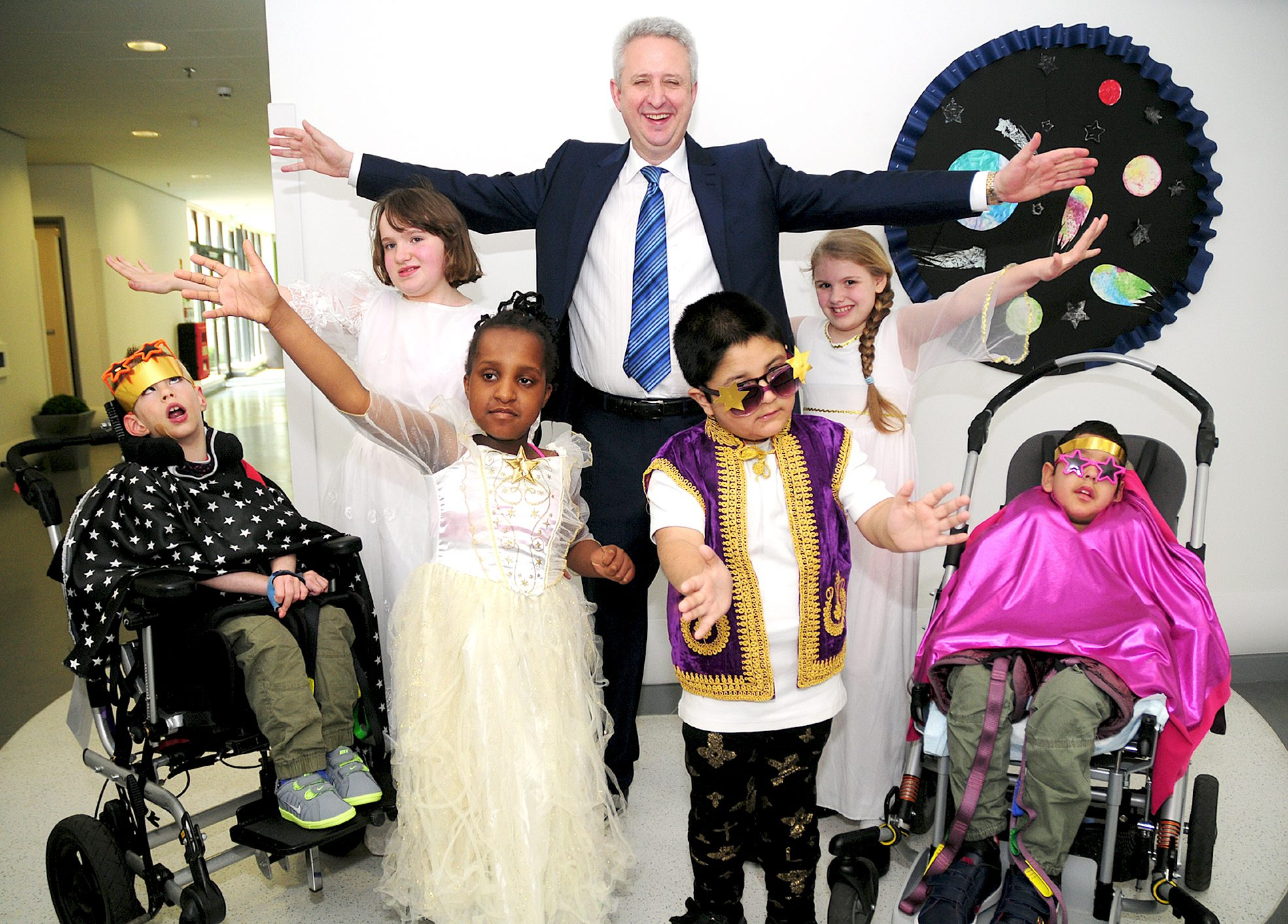 Back from left, Lochlan Riddel (aged eight), Isabella Clarke (aged 11), Ivan Lewis MP, Amber Whittaker (aged nine) and Ali Razabutt (aged nine). Front from left, Jasmin Gittens (aged eight) and Adeel Farooq (aged eight)